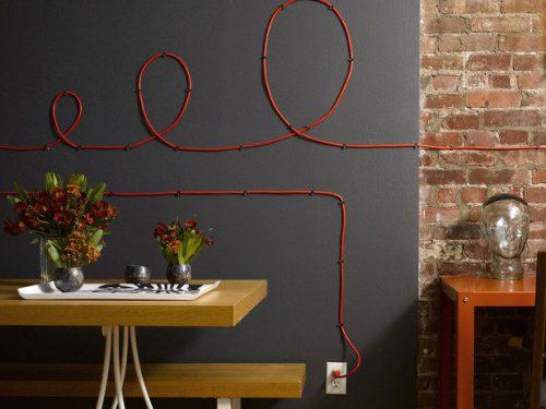 Praktiški patarimai norintiems paslėpti kabelių raizgalynę namuose